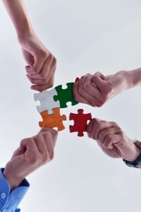 24337321 - group of business people assembling jigsaw puzzle and represent team support and help concept